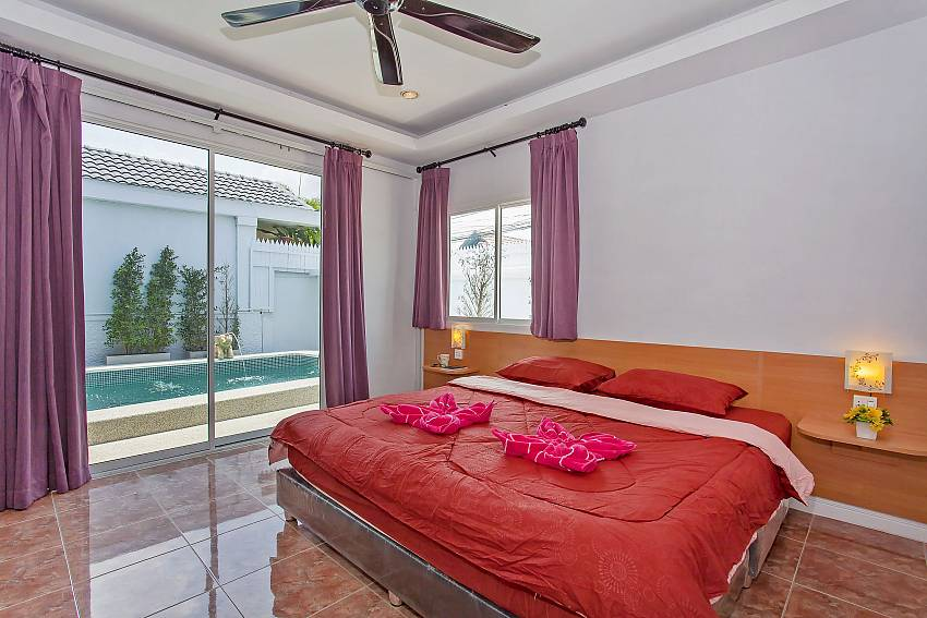 1. double bedroom with pool access at Vogue Villa Pattaya