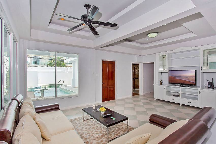 Spacious living room with TV and pool view at Vogue Villa Pattaya