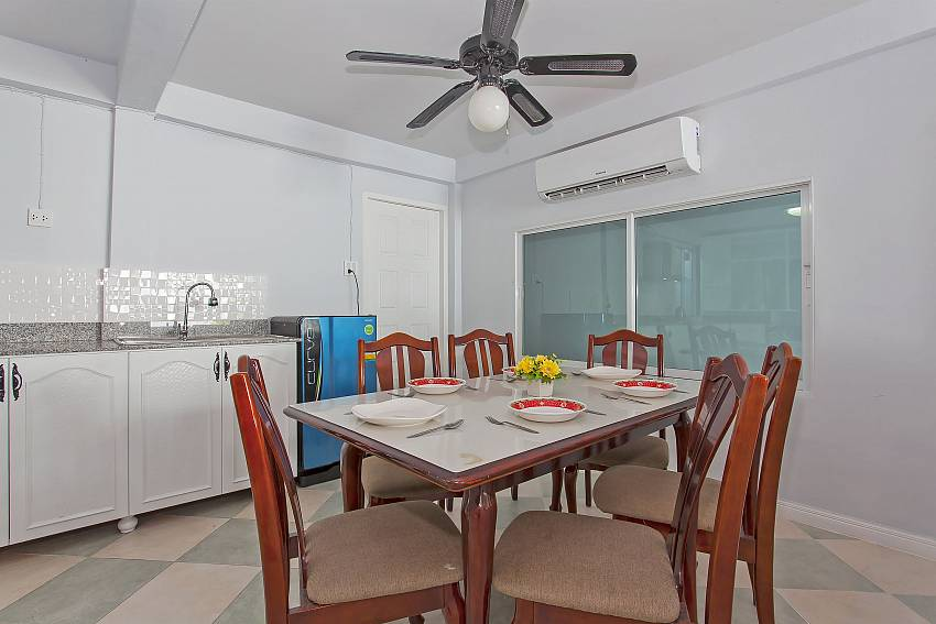 Dining table with modern kitchen in Vogue Villa Central Pattaya