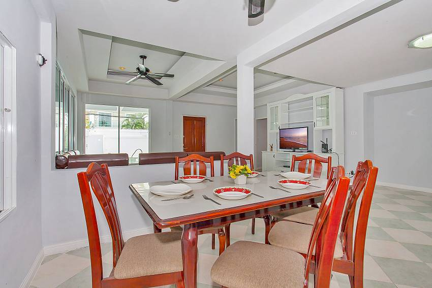 6 seat dining table between living room and kitchen Vogue Villa Pattya