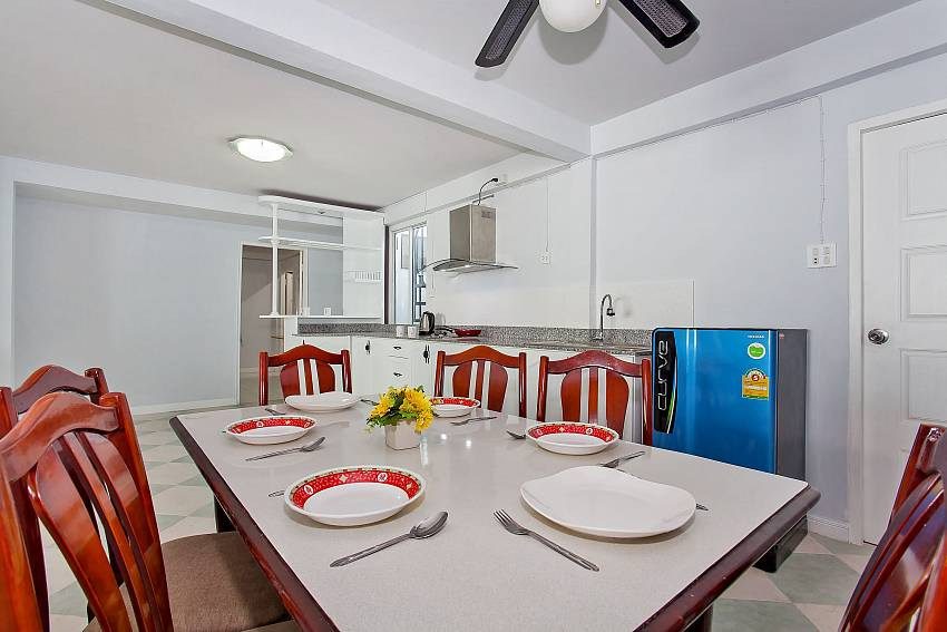 Dining table for 6 guests next to kitchen in Pattaya Vogue Villa