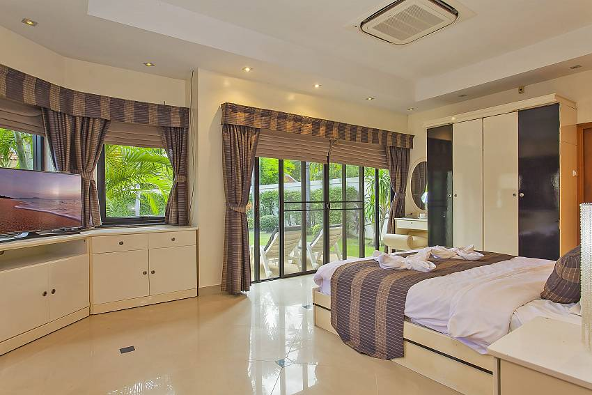 1. bedroom with flat TV and direct garden access in Pattaya Presidential Villa