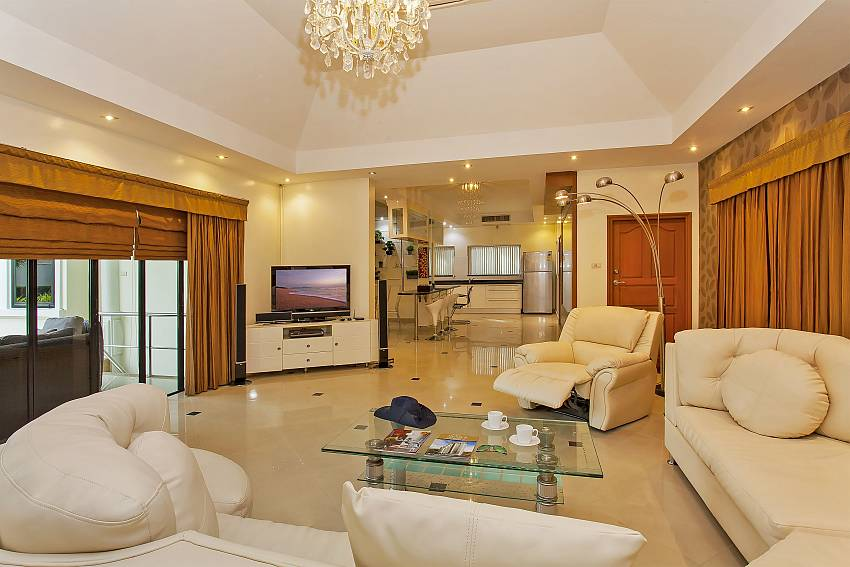 Open plan living room with huge sofa and TV at Pattaya Presidential Villa