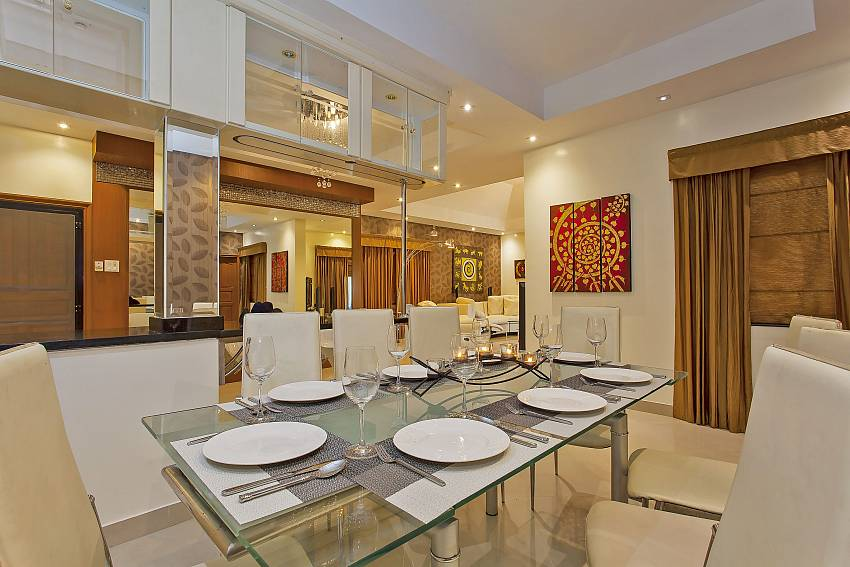 comfortable sitting at the 8 person dining table of Pattaya Presidential Villa
