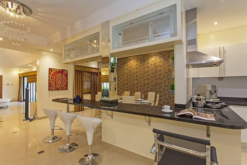 enjoy a snack at the bar next to the top-modern kitchen at Pattaya Presidential Villa