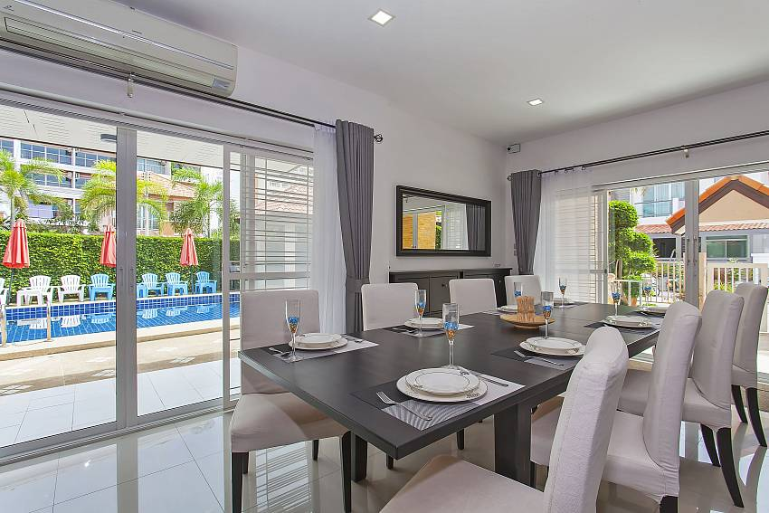 Dining area with pool view at Moonlight Villa in South-Pattaya