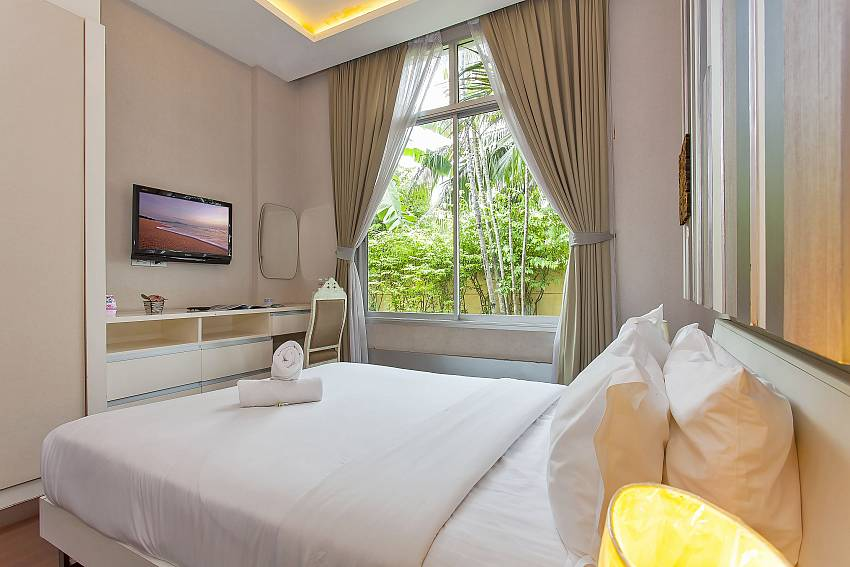 2. guest bedroom with TV and garden view at Silver Sky Villa Pattaya