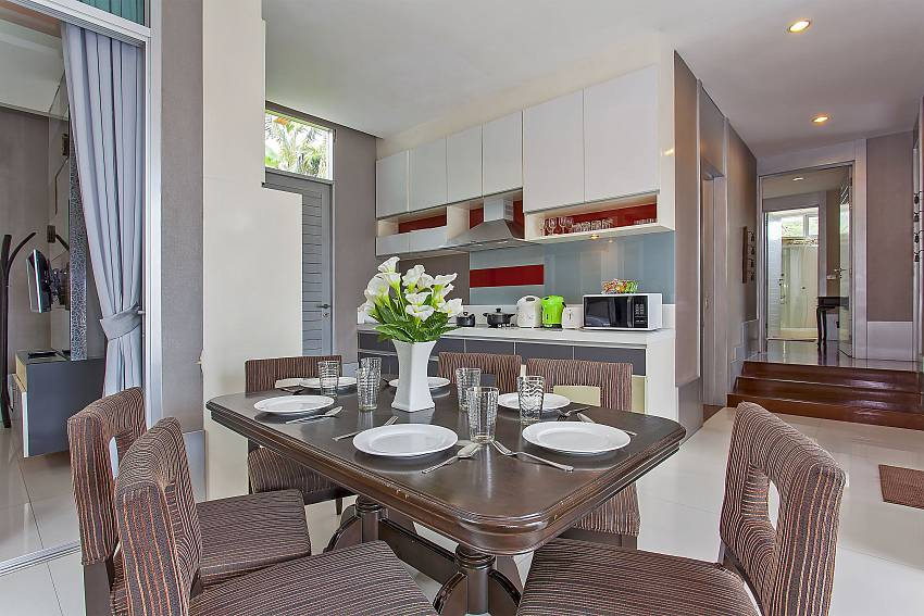 Dining table close to the kitchen at Silver Sky Villa in Pattaya