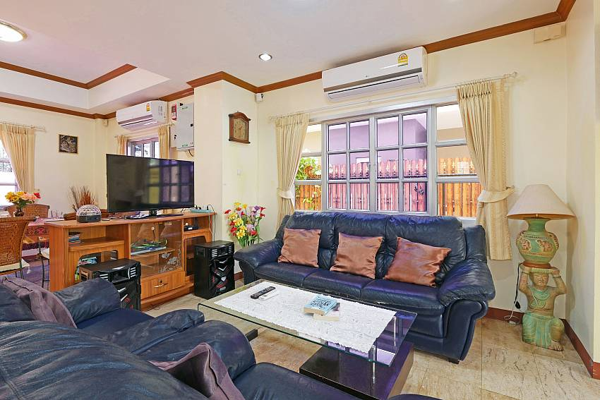 living room with TV and surround sound system in Villa Amiya Pattaya