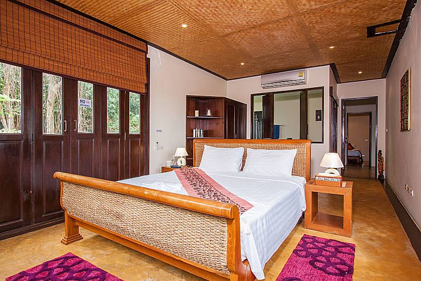 Comfortable double bed in 1. bedroom of Baan Pa Nom west coast Phuket