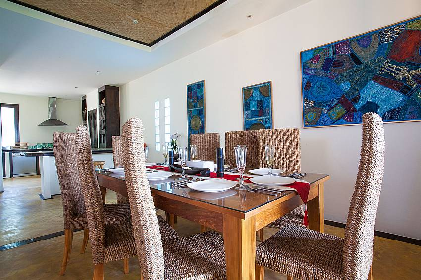 8-seat dining table close to the kitchen at Baan Pa Nom West Phuket