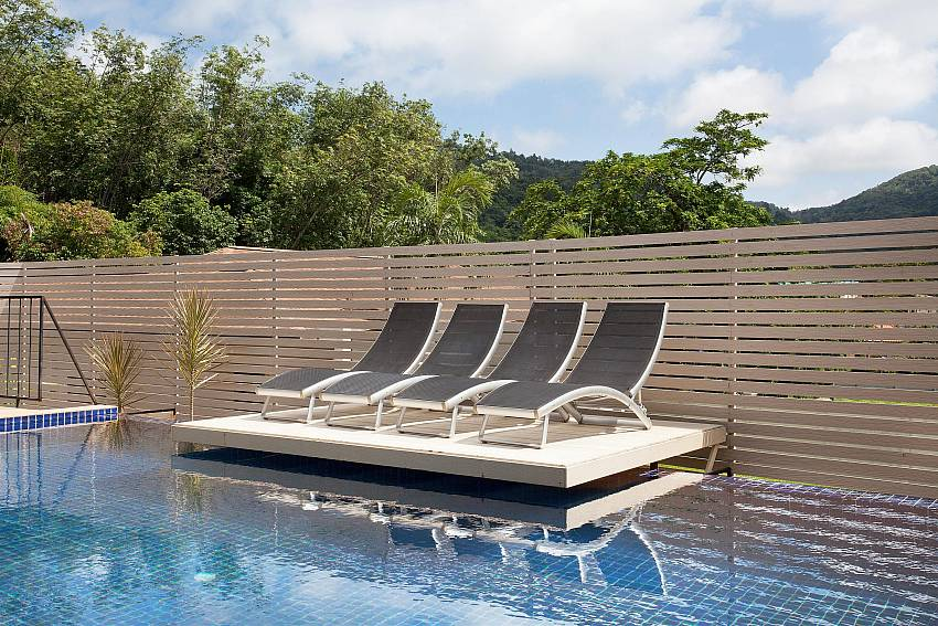 Sun beds at the private pool in Villa Kaimook Andaman Phuket