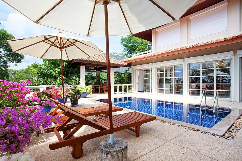 Relax in style at the pool deck in Ruedi Villa Phuket