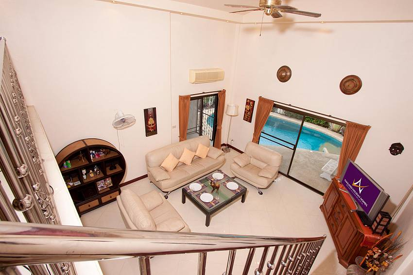 Cozy living area with pool view at Nai Mueang Noi Villa Pattaya