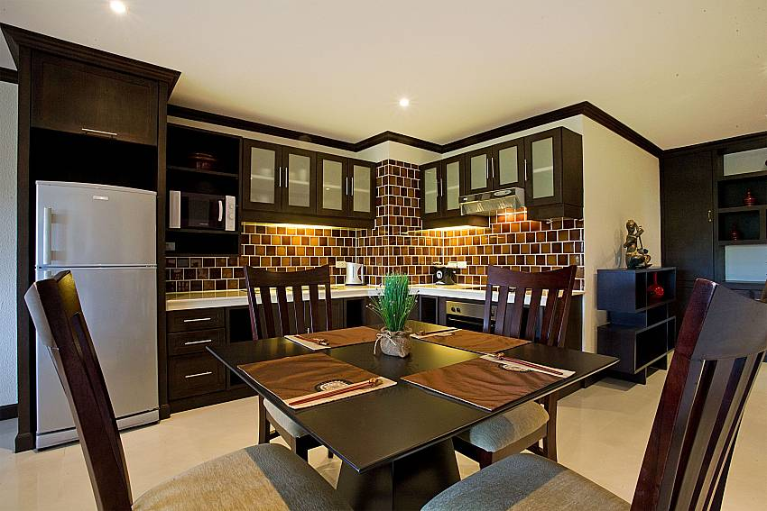 Cozy dining area by the kitchen at Nirvana Place in Pattaya