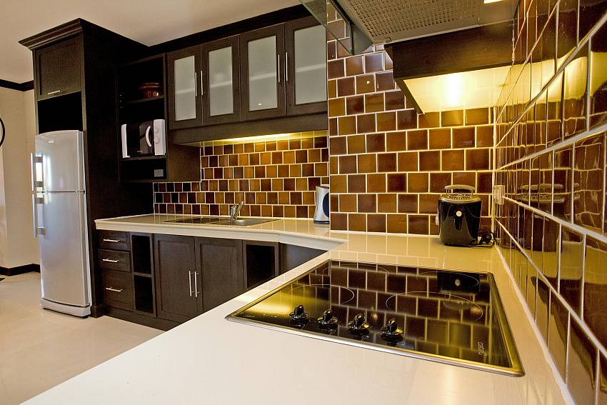 Modern kitchen at 2 bedroom holiday home Nirvana Place Pattaya