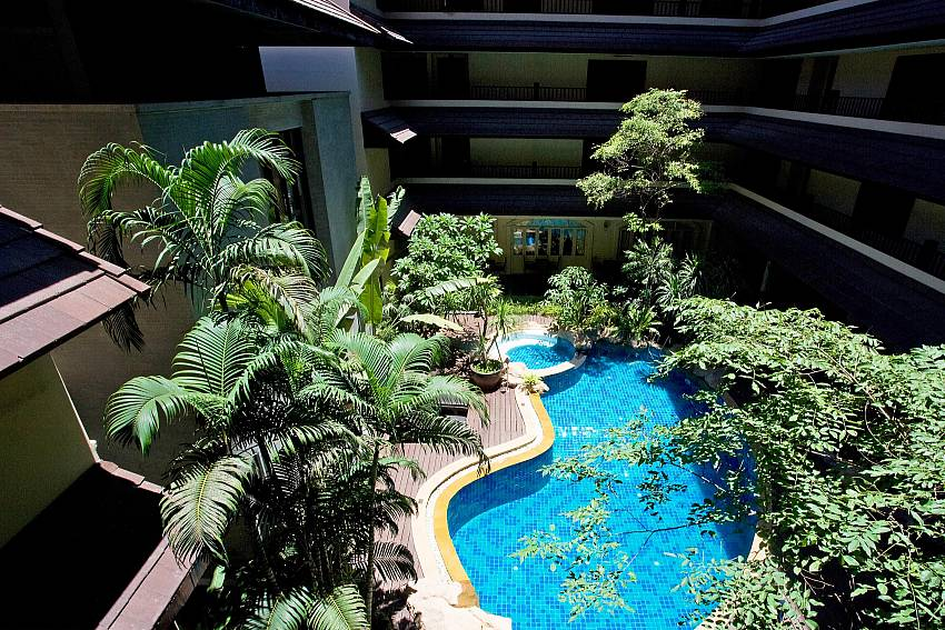 Lush tropical garden at the communal pool of Nirvana Place in Pattaya