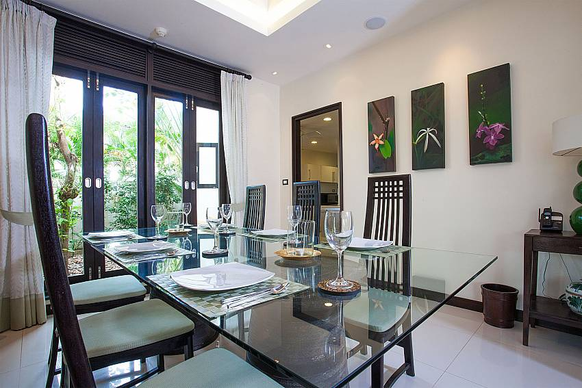 Comfortable dining inside Chom Tawan Villa in West Phuket