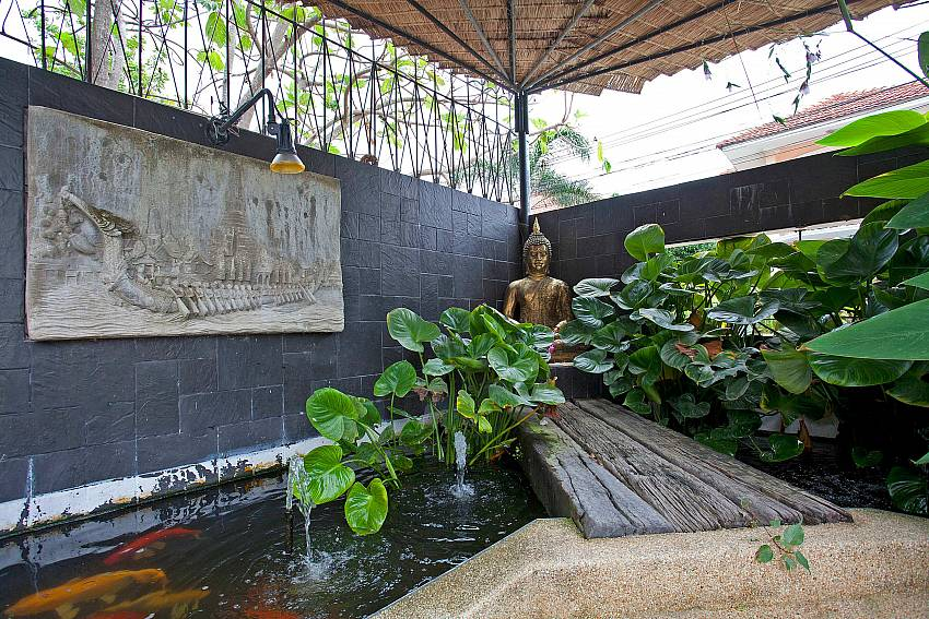 Water Feature with Tropical Plants Of Baan Kinaree