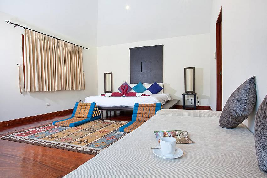 Beautiful bedroom with King-size bed and decor at Red Mountain Villa Phuket