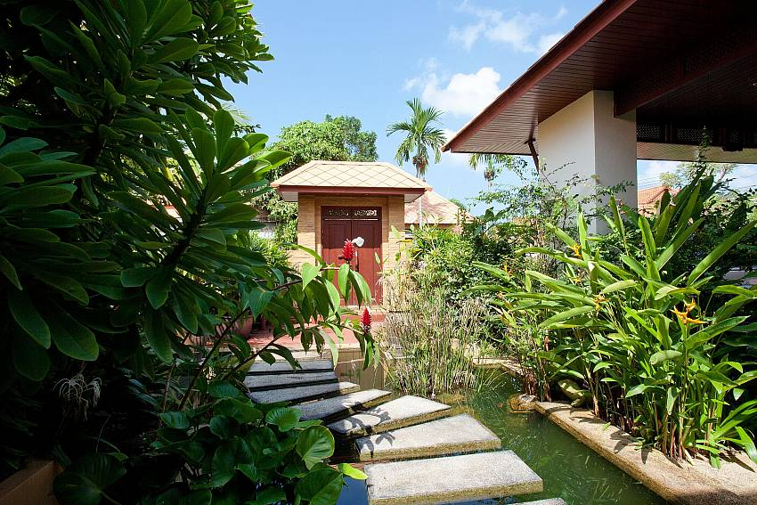 Tropical garden and pound at Villa Fantasea in Kamala West Phuket
