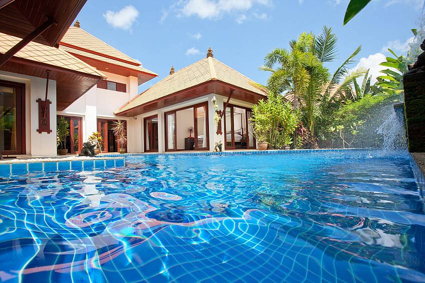 Private swimming pool with water features in Villa Fantasea Phuket