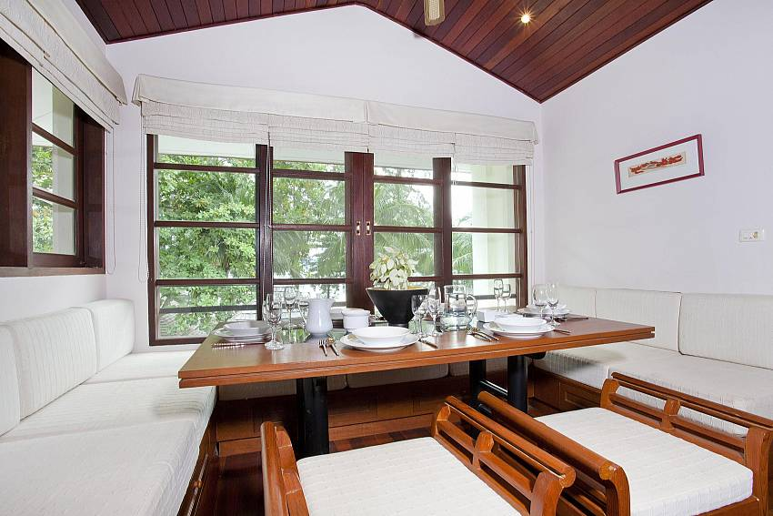 Big dining table at the Chai Nam Condo on Bang Tao Beach in West Phuket
