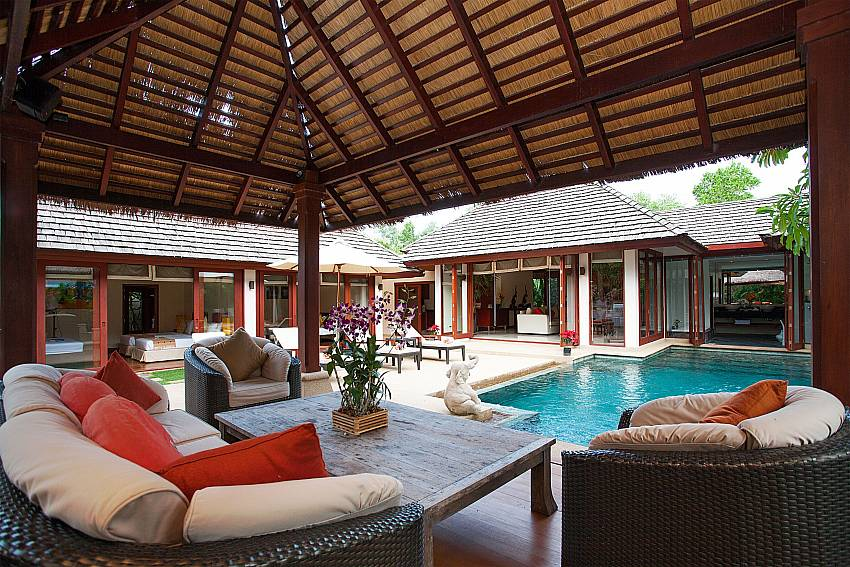 Shaded outdoor lounge by the pool in Bang Tao Bali Villa Phuket