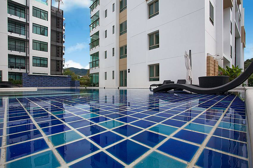 Relax by the communal swimming pool at Kamala Chic Apartment Phuket