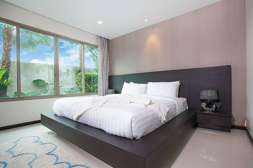 Comfortable king-size bed at Kamala Chic Apartment West Phuket