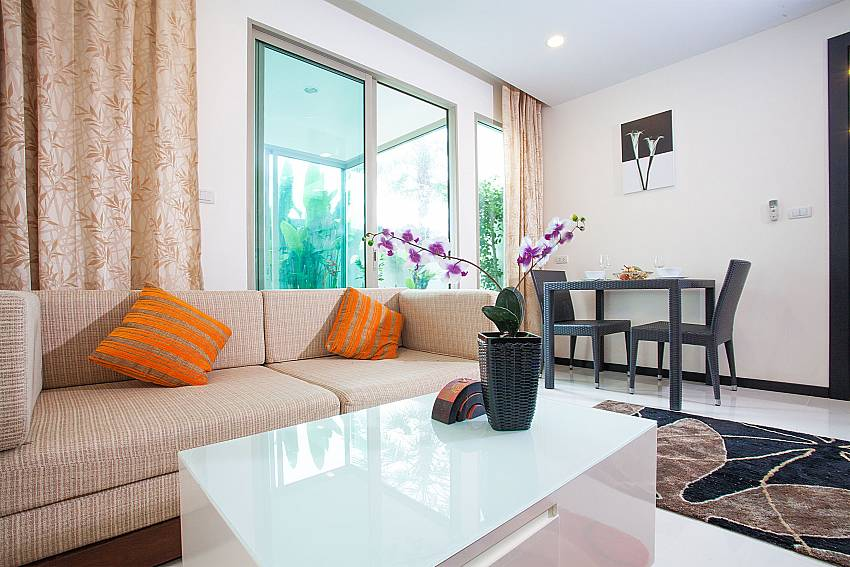 Open plan living and dining area at Kamala Chic Apartment West Phuket