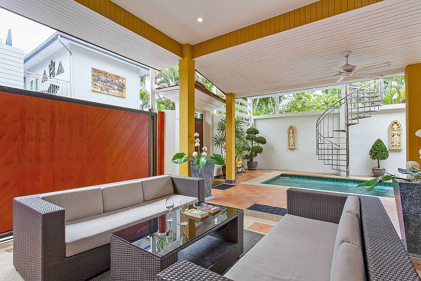Comfortable outdoor sitting area by the private pool at Sunny Villa Pattaya