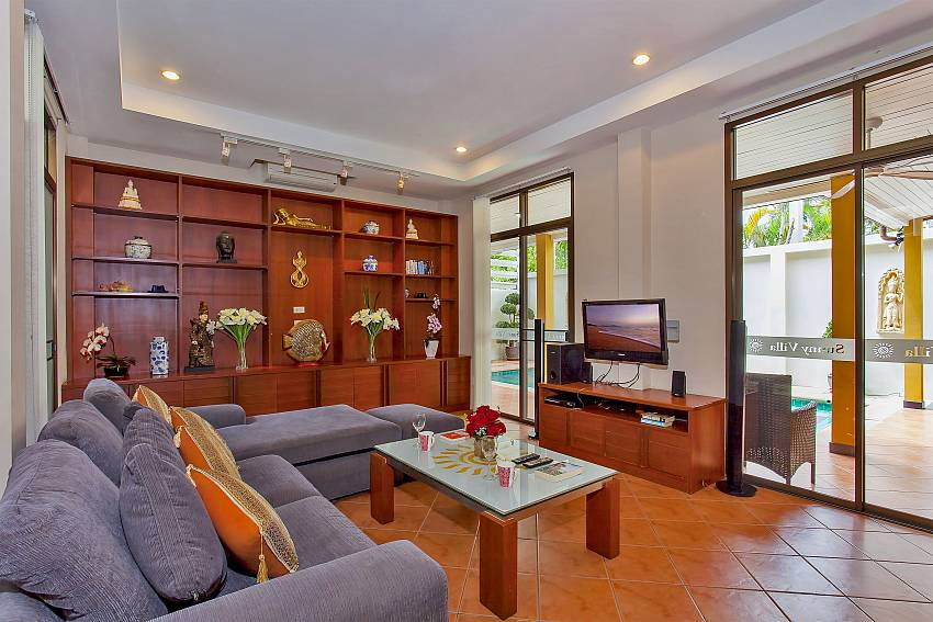 Living room with flat TV and access to the pool are of Sunny Villa Pattaya