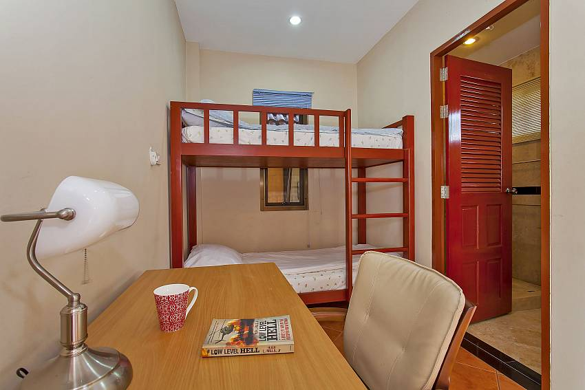 Desk with bunk bed at 2. double bedroom with ensuite bathroom at Pattaya Sunny Villa