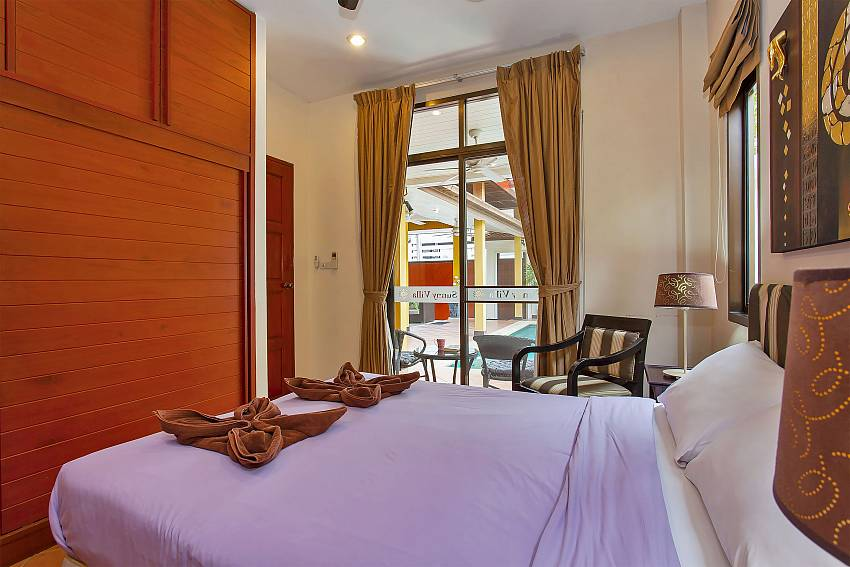 1. double bedroom with access to the pool area in Sunny Villa Pattaya