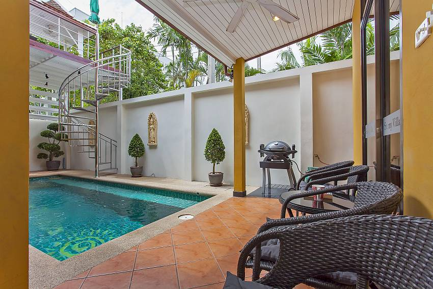 Seating area with BBQ around private pool at Sunny Villa Pattaya
