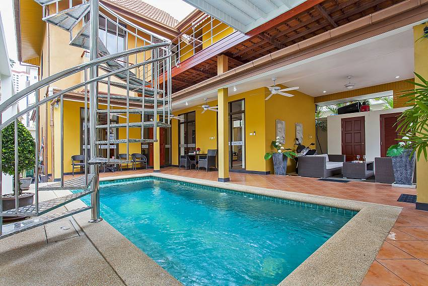 a staircase leads from the pool area to the upper terrace at Pattaya Sunny Villa