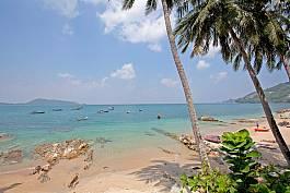 Take a boat and tour Kalim Bay