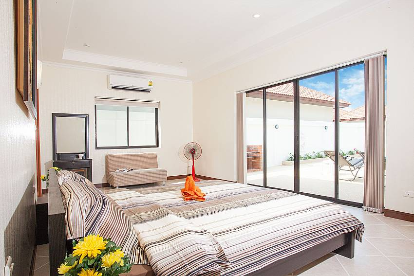 1. bedroom with king size bed and pool access at Insignia Villa Pattaya