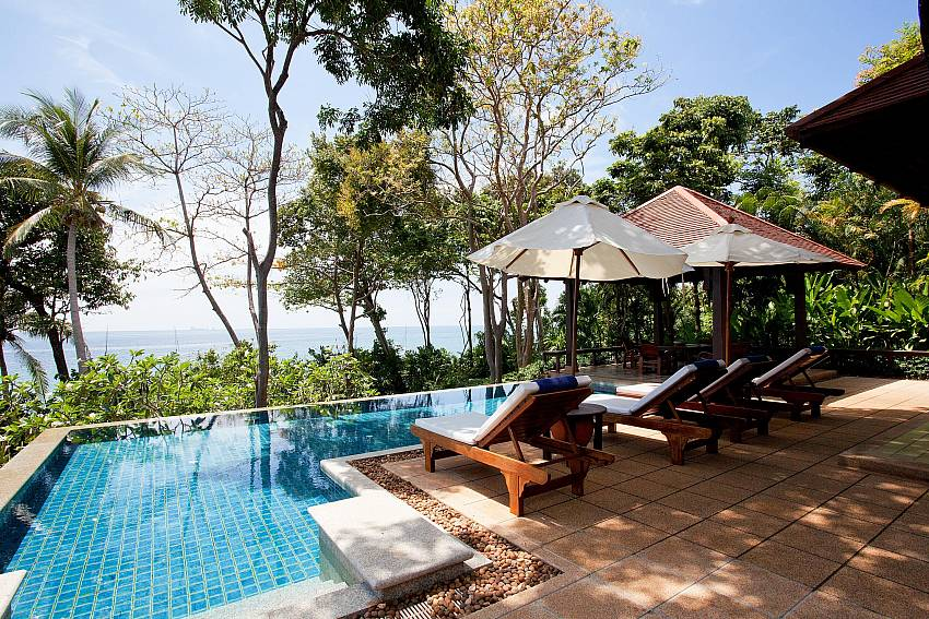 Sun bed by the pool Of Pimalai Beach Villa