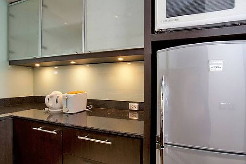 Refrigerator in the kitchen Of Sala Daeng Designer Suite Room 606