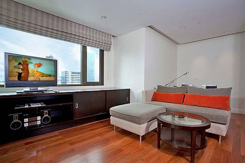Living room views with TV Of Sala Daeng Deluxe Suite Room 1207
