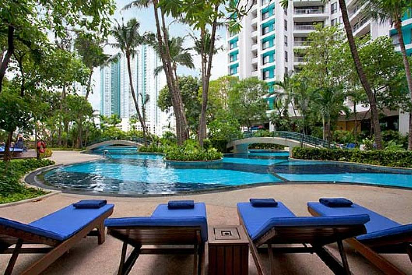 Sun bed by the pool Of Sathorn Suite Room 7073
