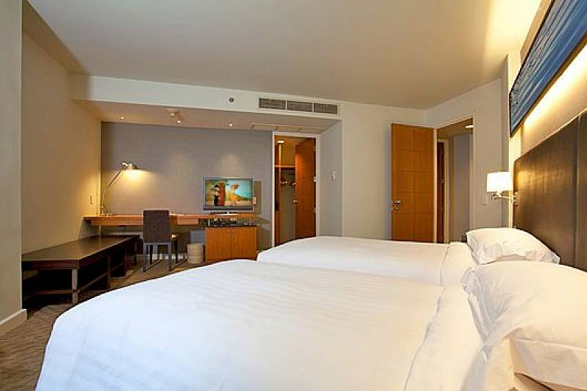 Double bedroom with desk Of Sathorn Suite Room 7071