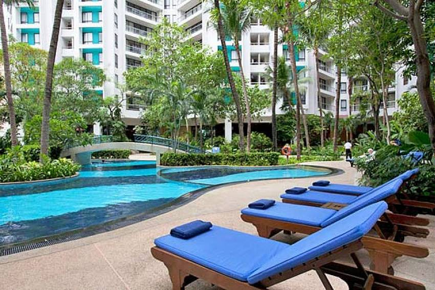 Sun bed by the pool Of Sathorn Suite Room 5151