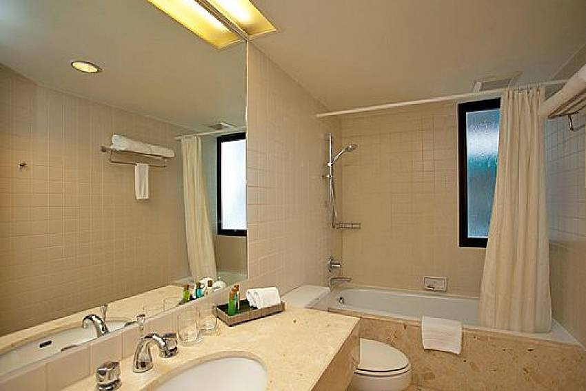 Jacuzzi tub with toilet Of Sathorn Suite Room 5151