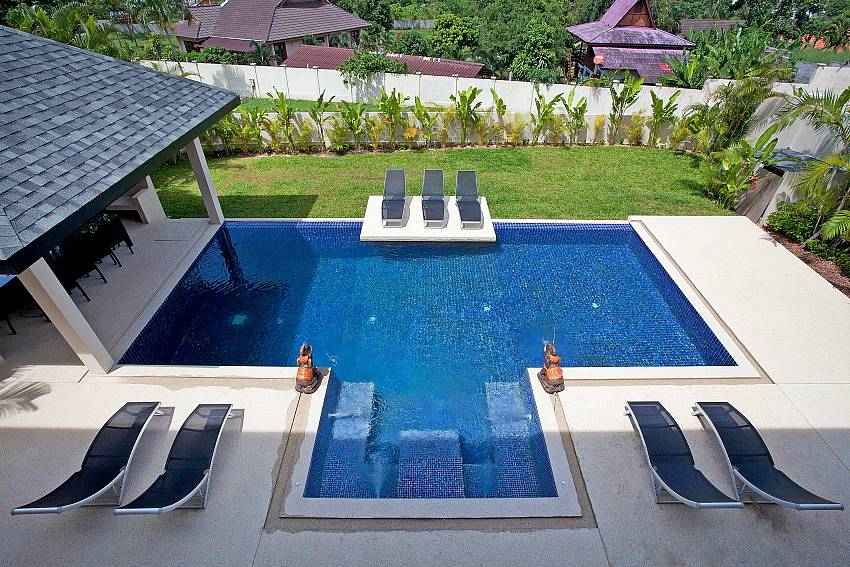 Sun bed by the pool Of Villa Yok Kiao