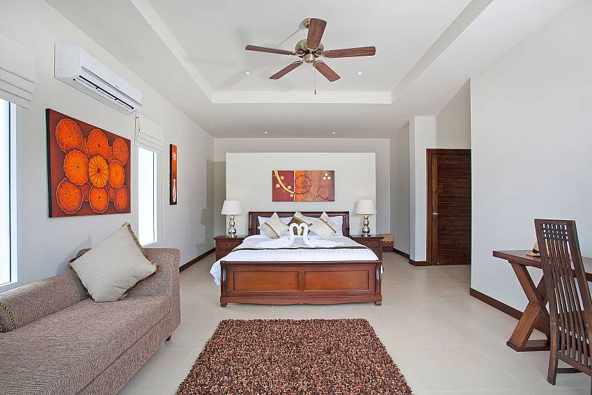 Bedroom with sofa Of Villa Ampai