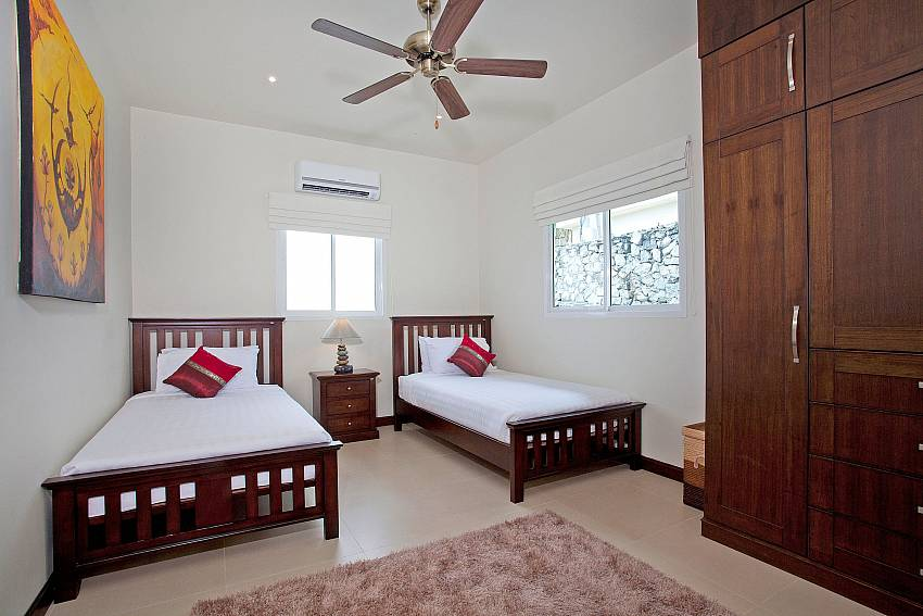 Double bedroom views with wardrobe Of Villa Ampai