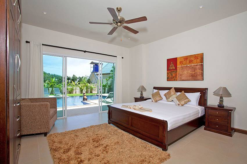 Bedroom near the pool Of Villa Ampai